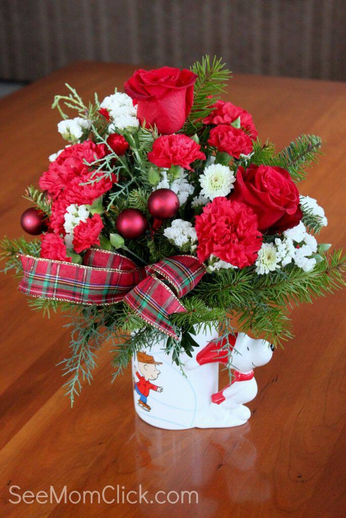 "This season Teleflora joins Charlie Brown, Snoopy, and the rest of the Peanuts gang in celebrating the 50th anniversary of ""A Charlie Brown Christmas."""