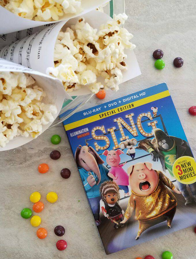 SING is out now on Blu-Ray and I've got tips for how to plan a SING family movie night that's easy and so much fun, music themed party snacks included!