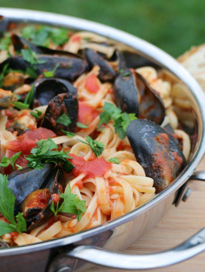 Here's a new one to add to your repertoire of delicious pasta recipes! Linguine With Mussels In Tomato Sauce is fresh and tasty and simple to make. This is a perfect dish to serve when entertaining guests. It's fancy yet easy to put together!